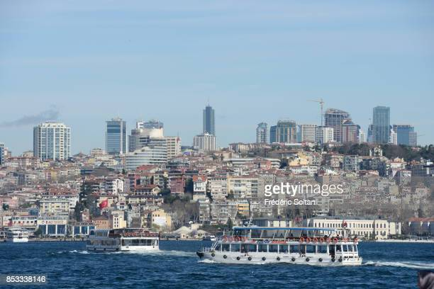 Ferry boat and new business district in Istanbul along the Bosphorus on 0ctober 15 2014 in Istanbul Turkey