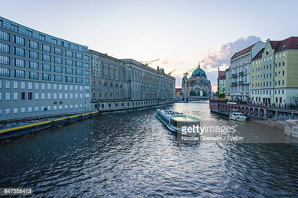 Ferry Boat In Spree River With Berlin Cathedral Against Sky