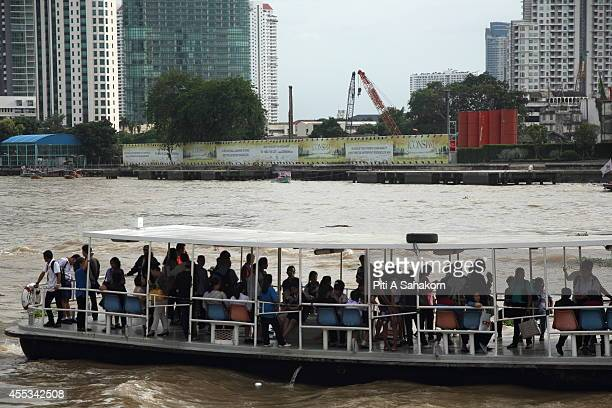 A ferry Boat pass through the construction site of ' Icon Siam ' the biggest community mall project in Thailand The THB 50billion Chao Phraya river...
