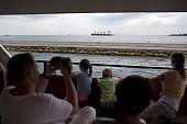 Ferry boat passengers watch a cargo ship sail along the Bosporus Strait in Istanbul Turkey on Wednesday July 20 2016 Moody's Investor Services said...