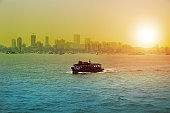 A ferry is a merchant vessel used to carry passengers, and sometimes vehicles and cargo as well, across a body of water. Most ferries operate regular return services. A passenger ferry with many stops