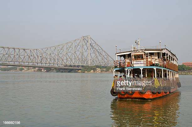 Ferry boats are connecting Kolkata and Howrah in front of the impressive 705 m long HowrahBridge