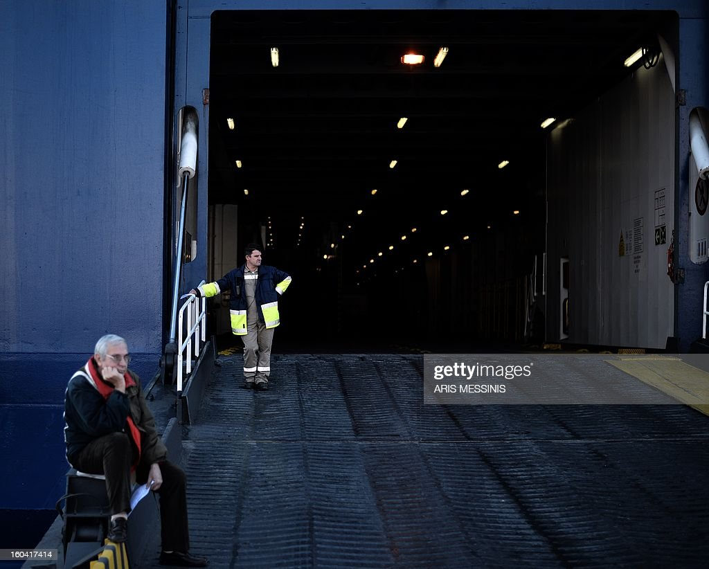 A ferry crew member stands at the ramp of a docked ferry at the port of Piraeus, near Athens, during a 48-hours strike on January 31, 2013. Sailors kicked off a two-day walkout, buses and trains were at a standstill and civil servants planned to hold a three-hour work stoppage against the government's cutbacks.