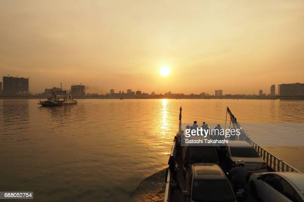 A ferry goes to Phnom Penh city across the Mekong river from Areiy Ksatr village