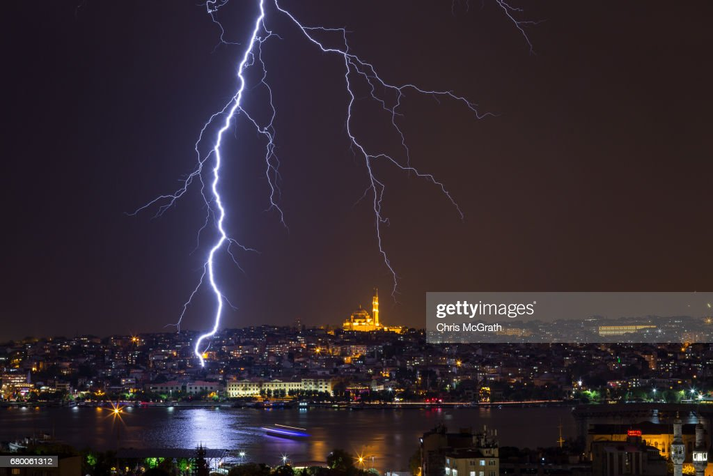 A ferry is seen crossing the Golden Horn as lightning strikes in front of the Fatih Mosque during a thunderstorm on May 7, 2017 in Istanbul, Turkey.