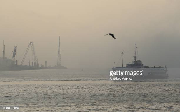 A ferry is seen during the heavy mist in Istanbul Turkey on July 27 2017