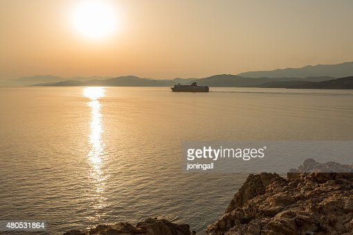 Ferry leaving port of Ile Rousse in Corsica : Stock Photo