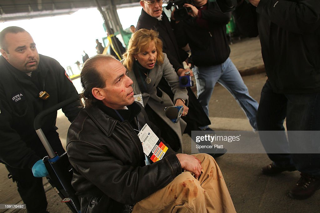 A ferry passenger speaks to the media following an early morning ferry accident during rush hour in Lower Manhattan on January 9, 2013 in New York City. About 50 people were injured in the accident, which left a large gash on the front side of the Seastreak ferry at Pier 11.