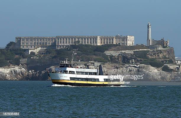 A ferry sails in front of Alcatraz Island on October 2 2013 in San Francisco California Alcatraz Island and all federal museums and parks across the...