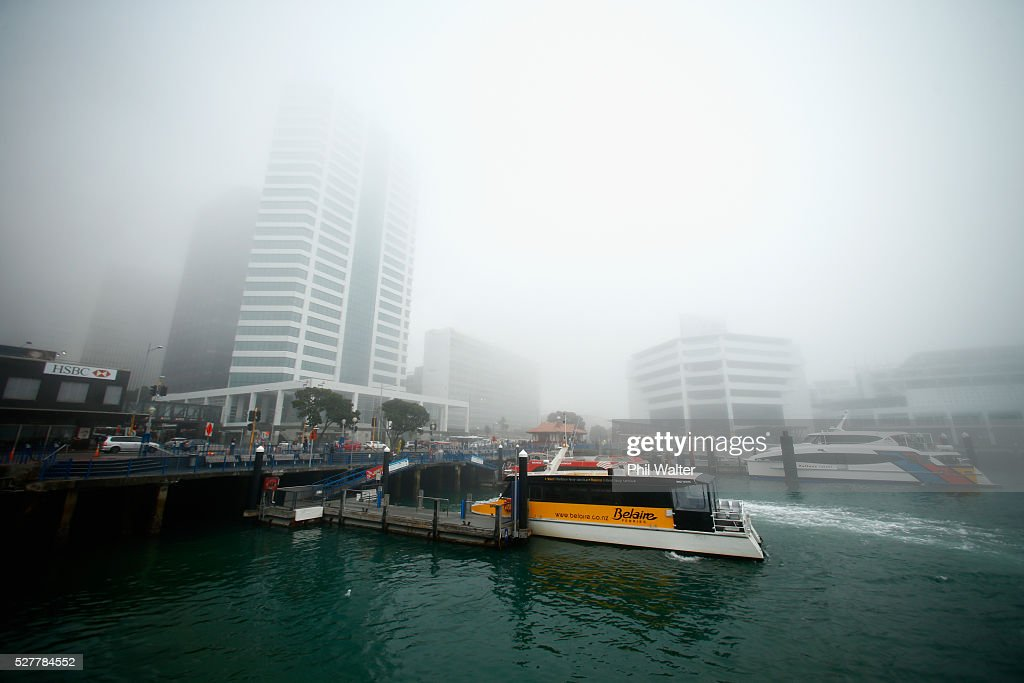 Ferry services arrive at the terminal as the CBD sits under a blanket of fog over Auckland City on May 4, 2016 in Auckland, New Zealand. The morning fog disrupted flights and ferry services in the city.