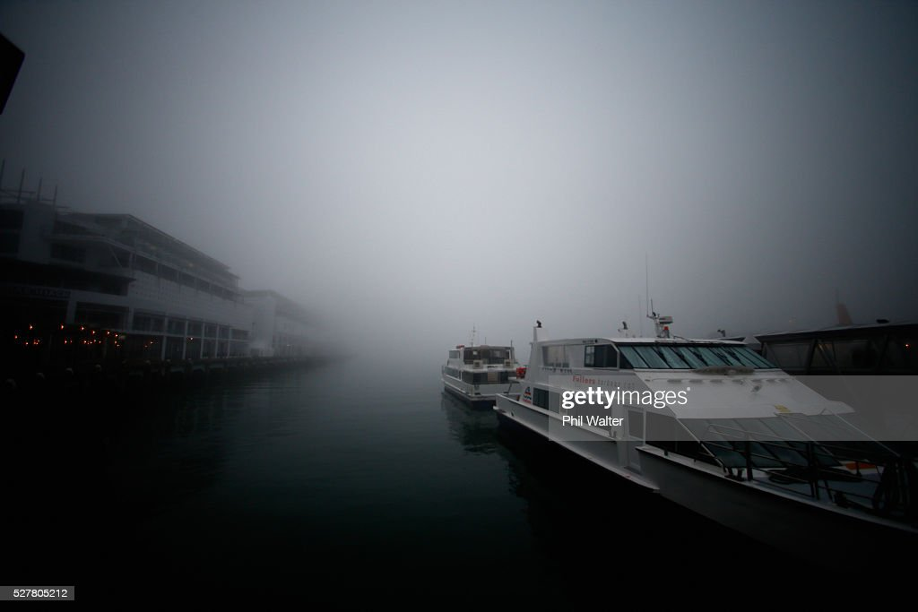 Ferry services sit at the terminal as the CBD sits under a blanket of fog over Auckland City on May 4, 2016 in Auckland, New Zealand. The morning fog disrupted flights and ferry services in the city.
