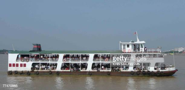 A ferry transports passengers from Dala township to Yangon during the morning rush hour on the Yangon River 24 October 2007 It is often argued that...