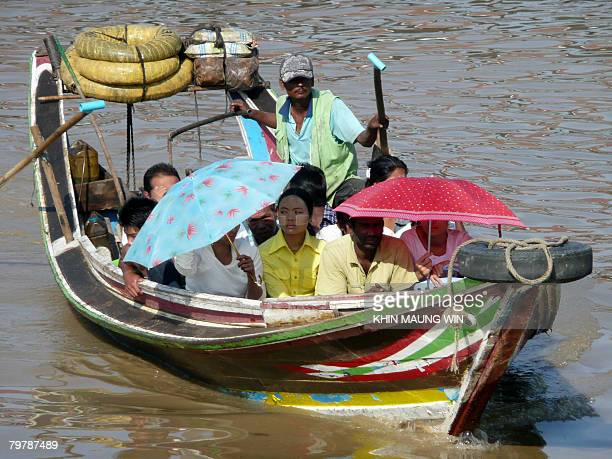 A ferry transports passengers from Thamada Beach to Bohtataung Jetty in Yangon on February 15 2008 While Myanmar is blessed with resources including...