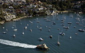 A ferry travels past pleasure boats into Sydney harbour on May 15 2013 Sydney ferries transport thousands of people daily from Manly at the northern...