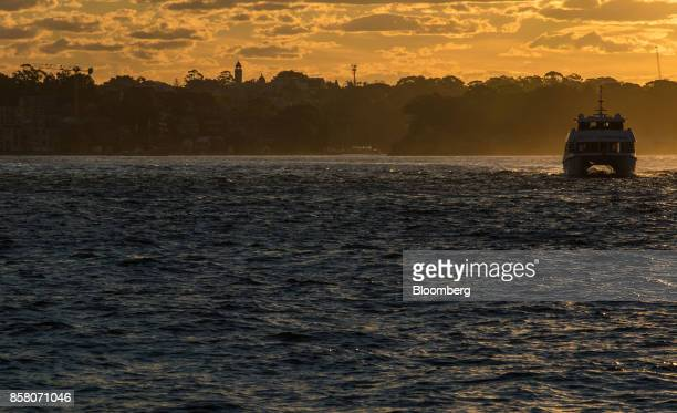 A ferry travels towards Circular Quay during sunset in Sydney Australia on Friday Sept 29 2017 Twentysix years without recession have put Australia...