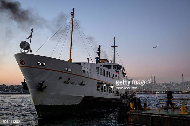 A ferry worker waits to dock an early morning ferry at Karakoy pier on December 14 2015 in Istanbul Turkey Istanbul in Turkey's northwest is the only...