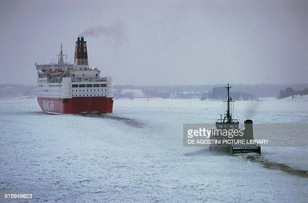 Ferryboat and icebreaker in the frozen Baltic Sea Finland