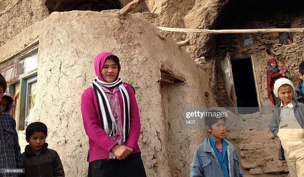 Fershat stands in front of her cave school in Patokhlama, Afghanistan, which is operated by the aid group PARSA and provides literacy and math programs for 28 of the kids in the community who are too small to attend PARSA's main school in Bamiyan.