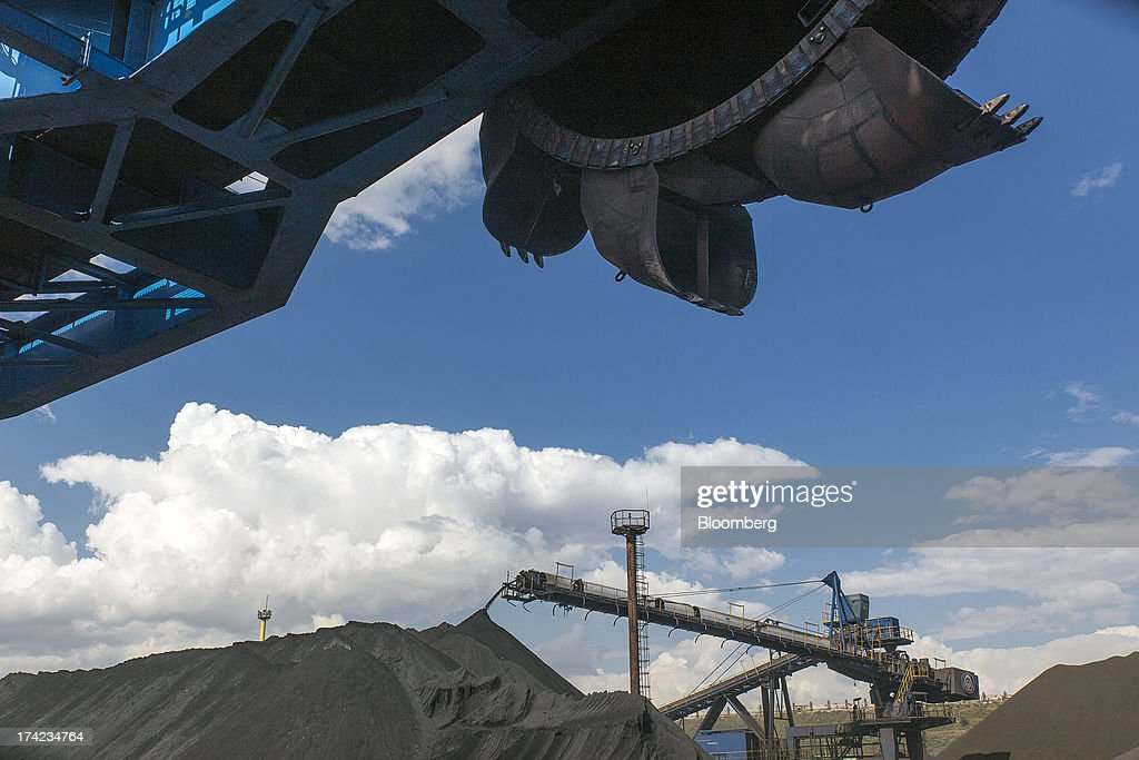 Fertilizer falls from a conveyor belt on a coal moving machine into storage piles for export in Yuzhny port, operated by TIS Group, near Odessa, Ukraine, on Friday, July 19, 2013. Ukraine wants to cut current-account deficit to 3%-4% of GDP in medium term, central bank official Serhiy Nikolaychuk tells reporters in Kiev. Photographer: Vincent Mundy/Bloomberg via Getty Images
