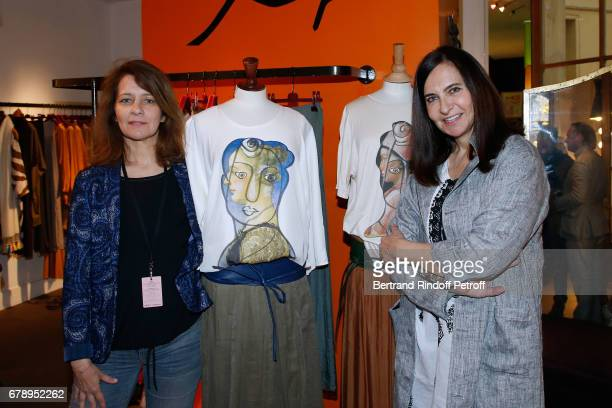 Fervel Lakhdar and Nathalie Garcon attend the Cocktail 'Art is doing well' 'L'art se porte bien' Exhibition of the creations of the Tunisian artist...