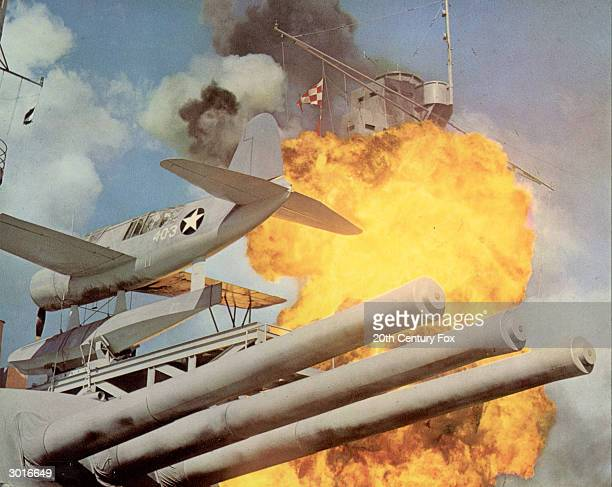 A fery explosion occurs on the deck of a US aircraft carrier during a recreation of the Japanese attack on Pearl Harbor in a still from the film...