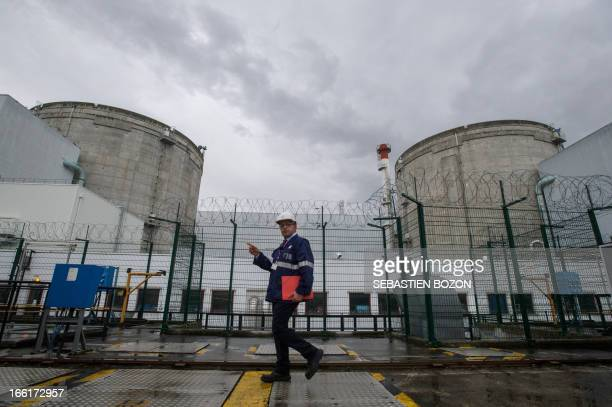 Fessenheim nuclear power plant director Thierry Rosso passes by reactors during a press visit on April 9 in Fessenheim eastern France AFP PHOTO /...