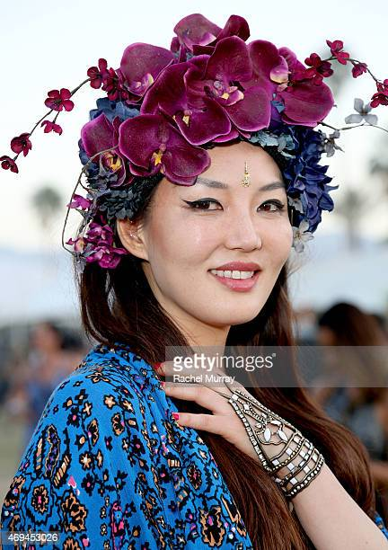 Festival attendee Catherine Ahn wearing a Ms G designs floral headdress during the 2015 Coachella Valley Music and Arts Festival Weekend 1 at The...