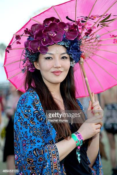 Festival attendee Catherine Ahn wears a floral headdress from Ms G designs during the 2015 Coachella Valley Music and Arts Festival Weekend 1 at The...