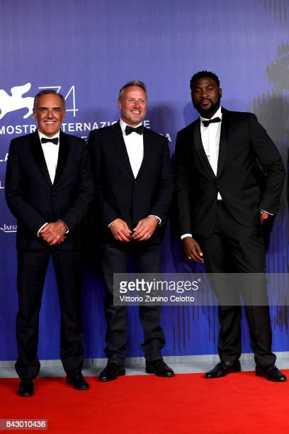 Festival director Alberto Barbera François Troukens and William Kaloubi walk the red carpet ahead of the 'Above The Law ' screening during the 74th...