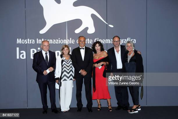 Festival director Alberto Barbera Mariella Li Sacchi and Amedeo Letizia walk the red carpet ahead of the 'Nato A Casal Di Principe' screening during...