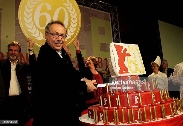 Festival director Dieter Kosslick blows sixty candles on a birthday cake during the 60th Berlin Film Festival Press Conference on February 1 2010 in...