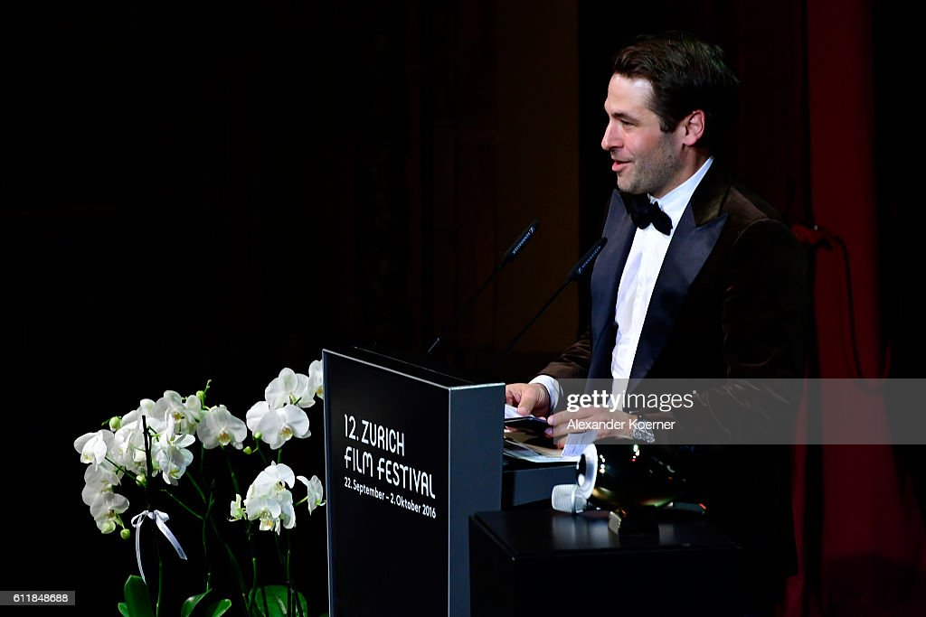 Festival director Karl Spoerri presents the 'Tribute to...' award on stage during the Award Night Ceremony during the 12th Zurich Film Festival on October 1, 2016 in Zurich, Switzerland. The Zurich Film Festival 2016 will take place from September 22 until October 2.