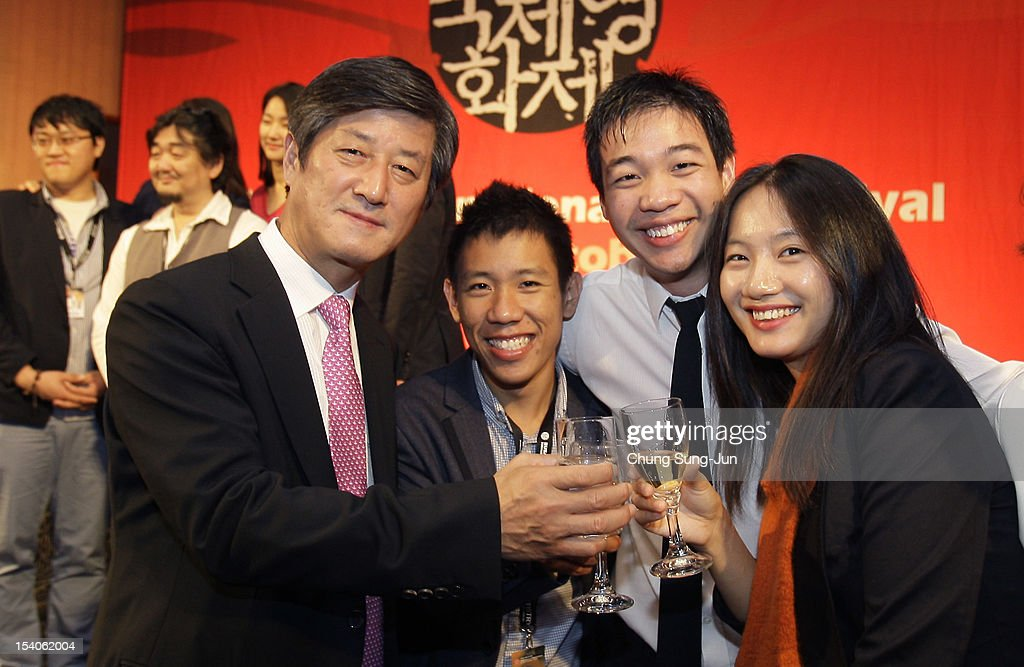 Festival director Lee Yong-Kwan (L) and AAA (Asian Actors Academy) students attend a closing party during the 17th Busan International Film Festival (BIFF) at Grand Hotel on October 13, 2012 in Busan, South Korea. The biggest film festival in Asia showcases 304 films from 75 countries and runs from October 4-13.