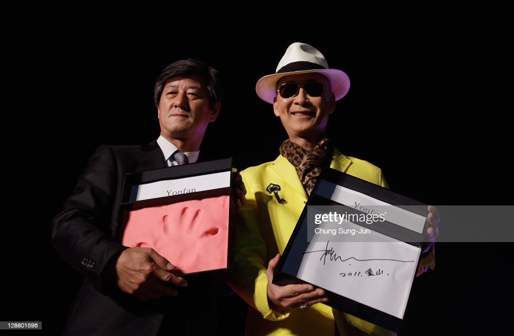 Festival director Lee Yong-Kwan and director Yonfan attend the Hand printing event during the 16th Busan International Film Festival (BIFF) at Haeundae seashore on October 8, 2011 in Busan, South Korea. The biggest film festival in Asia showcases 307 films from 70 countries and runs from October 6-14.