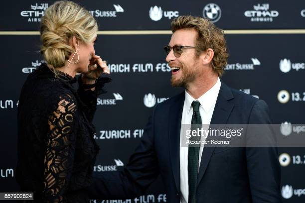Festival director Nadja Schildknecht and Simon Baker attend the 'Breath' premiere at the 13th Zurich Film Festival on October 5 2017 in Zurich...