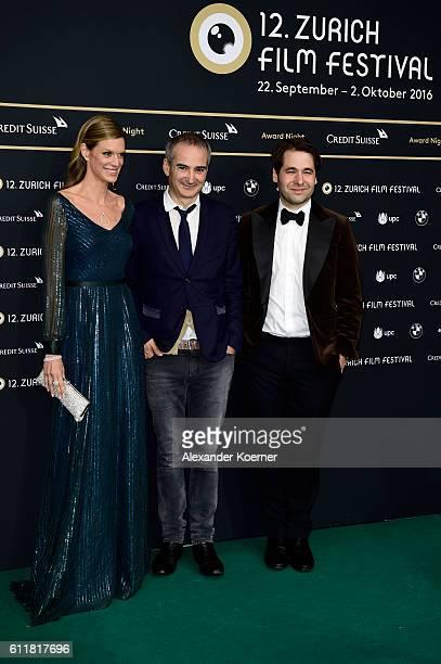 Festival director Nadja Schildknecht Olivier Assayas and Festival director Karl Spoerri attend the Award Night during the 12th Zurich Film Festival...