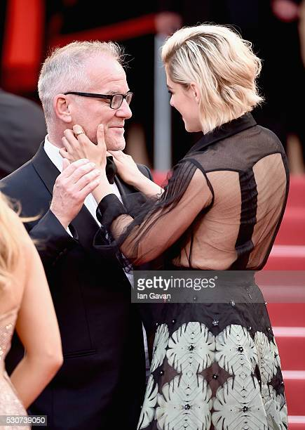 Festival Director Thierry Fremaux and actress Kristen Stewart attend the 'Cafe Society' premiere and the Opening Night Gala during the 69th annual...