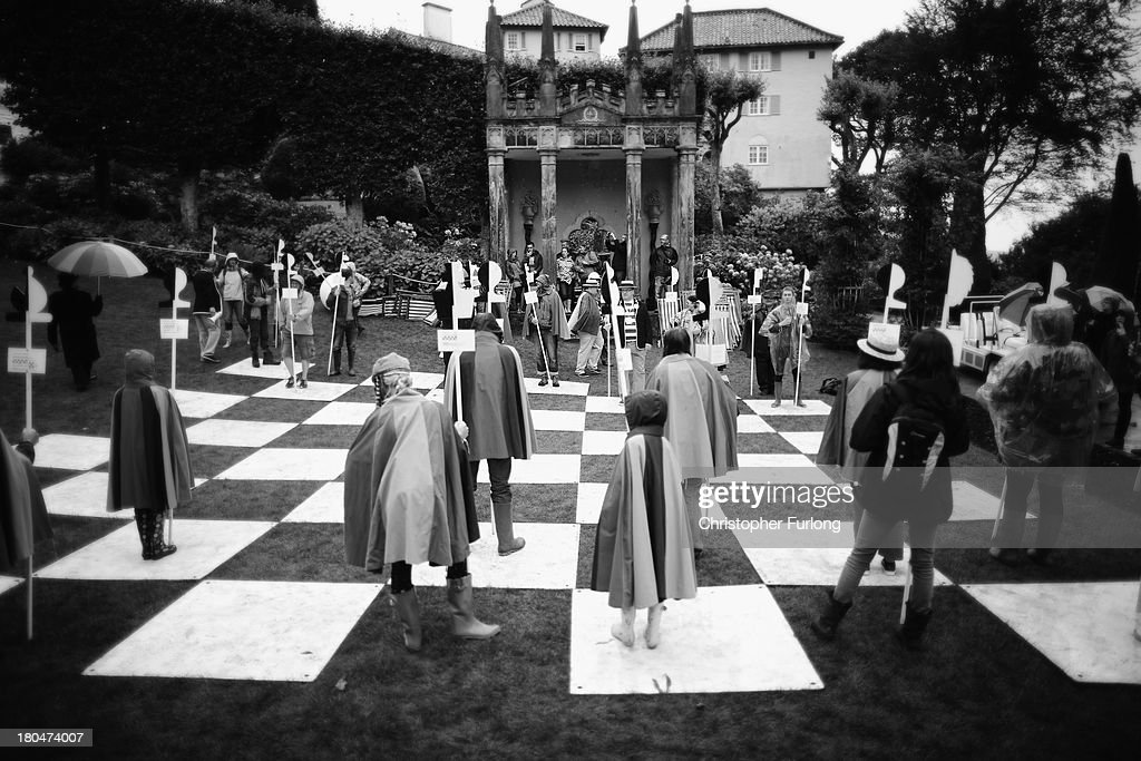 Festival fans play on the human chess board from the cult TV series The Prisoner during Festival No. 6 on September 13, 2012 in Portmeirion, United Kingdom. The classic Italianate village of Portmeirion in North Wales is staging its second No. 6 Festival, named after the famous 1960's cult TV series ''The Prisoner'' which was filmed in the village. The award winning three day festival is a kaleidoscope of entertainment with music, art and performances ranging from poetry to pop and classical music.