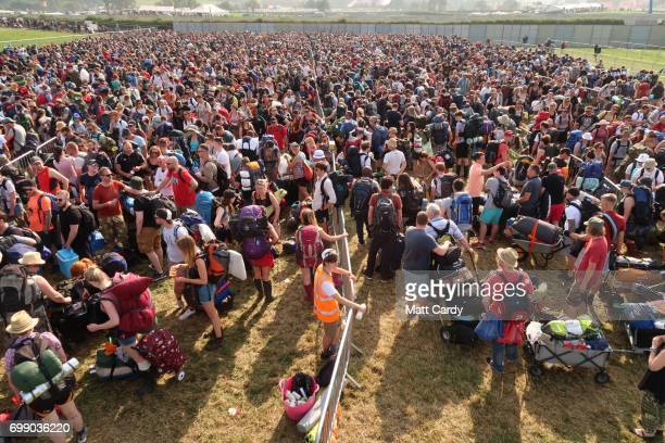 Festival fans queue as the gates open at the Glastonbury Festival amid heightened security at Worthy Farm in Pilton on June 21 2017 near Glastonbury...