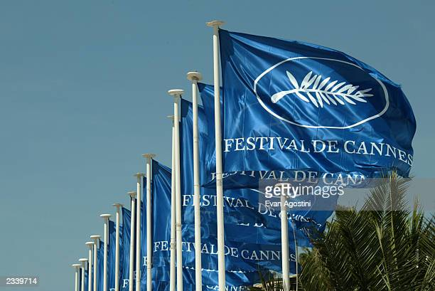 Festival flags are seen at the Palais Des Festival during 56th International Cannes Film Festival May 15 2003 in Cannes France