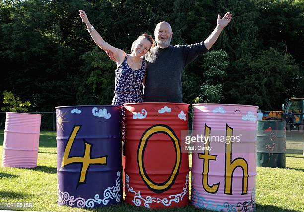 Festival founder Michael Eavis and his daugher Emily pose for a photograph besides litter bins that have been decorated to celebrate the Festival's...
