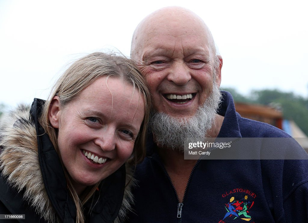 Festival founder Michael Eavis and his daughter Emily pose for a photograph at the Glastonbury Festival of Contemporary Performing Arts site at Worthy Farm, Pilton on June 27, 2013 near Glastonbury, England. Gates opened on Wednesday at the Somerset Diary Farm that will be playing host to one of the largest music festivals in the world and this year features headline acts Artic Monkeys, Mumford and Sons and the Rolling Stones. Tickets to the event which is now in its 43rd year sold out in minutes and that was before any of the headline acts had been confirmed. The festival, which started in 1970 when several hundred hippies paid 1 GBP to watch Marc Bolan, now attracts more than 175,000 people over five days.