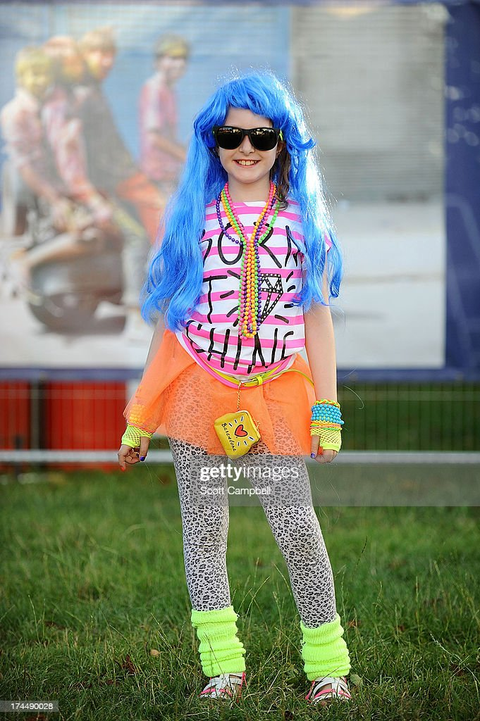 Festival goer Abbie Kirk, age 8 from Essex, poses in fancy dress during Rewind 80s Festival 2013 at Scone Palace on July 26, 2013 in Perth, Scotland.