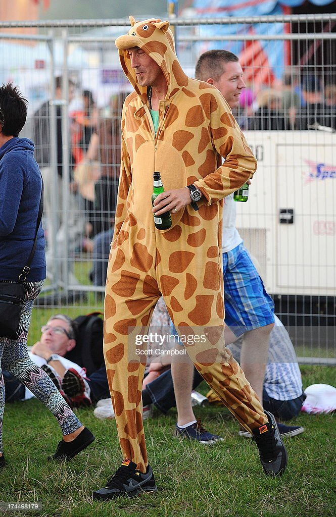 A festival goer dressed as a giraffe during Rewind 80s Festival 2013 at Scone Palace on July 26, 2013 in Perth, Scotland.