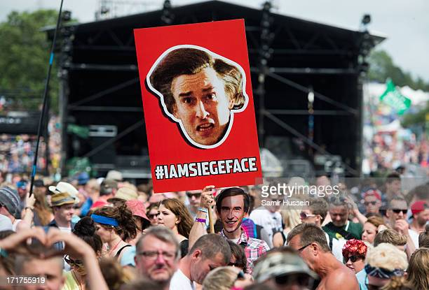 A festival goer dresses at Alan Partridge at the Glastonbury Festival of Contemporary Performing Arts at Worthy Farm Pilton on June 28 2013 in...
