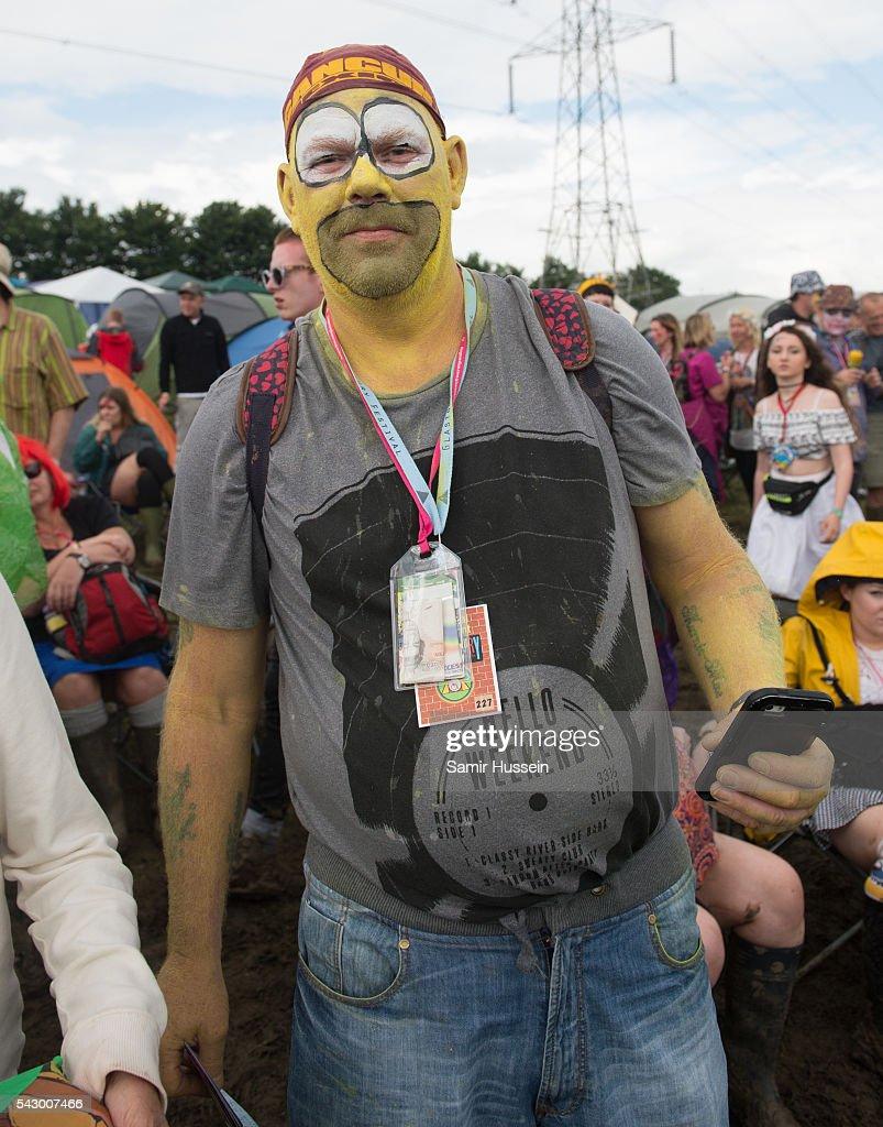 A festival goer enjoys Glastonbury Festival 2016 at Worthy Farm, Pilton on June 25, 2016 in Glastonbury, England.