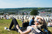 A festival goer enjoys the Glastonbury Festival at Worthy Farm Pilton on June 25 2015 in Glastonbury England