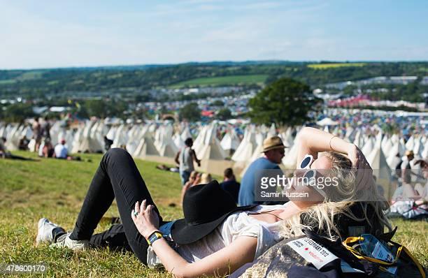 A festival goer enjoys the Glastonbury Festival at Worthy Farm Pilton on June 25 2015 in Glastonbury England
