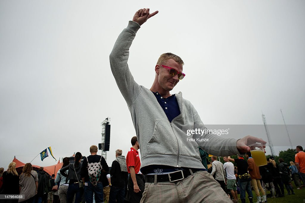 A festival goer enjoys the Roskilde Festival 2012 on July 6, 2012 in Roskilde, Denmark.