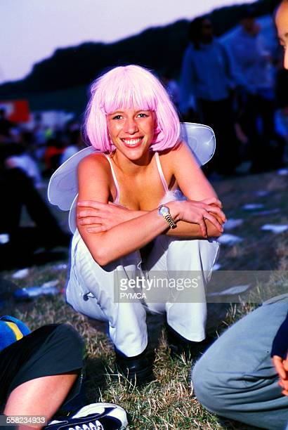 A festival goer in a pink wig and fairy wings Creamfields UK 2000s